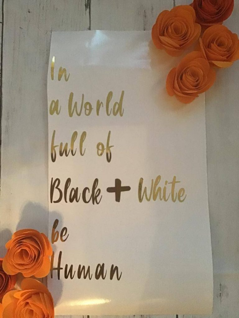 An outline of a wall hanging or shadow box idea using a quote and some paper flowers.