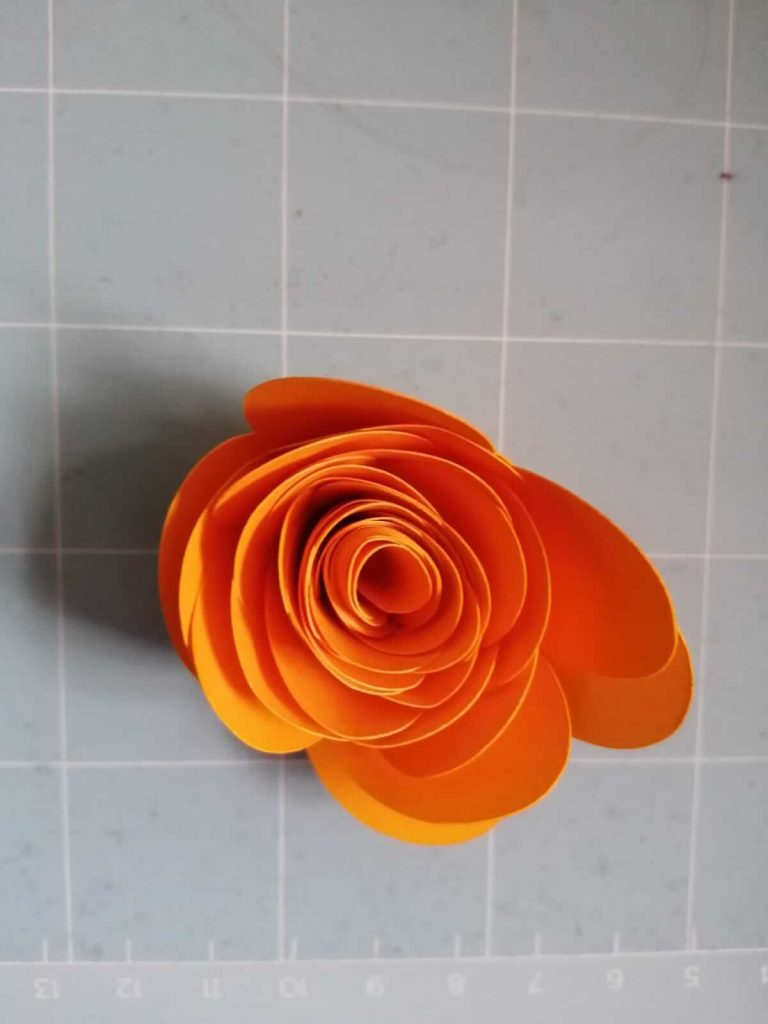 this is an orange colour paper rose flower