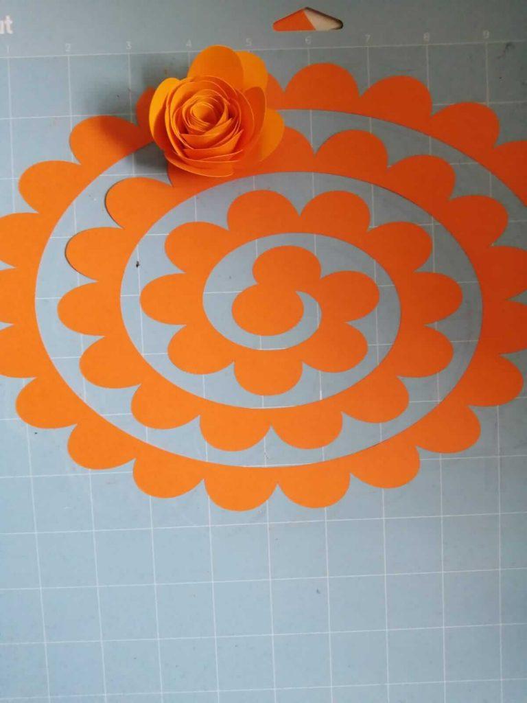 a cutout of an orange flower rose